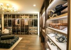 Walk-in closet with glass transperent doors