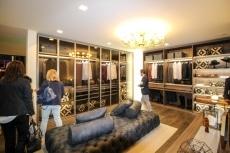 Walk-in closet with glass teca doors