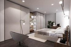 Bedroom with glass door sliding closet