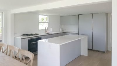 Minimal modern lacquered kitchen in picturesque Hampton.