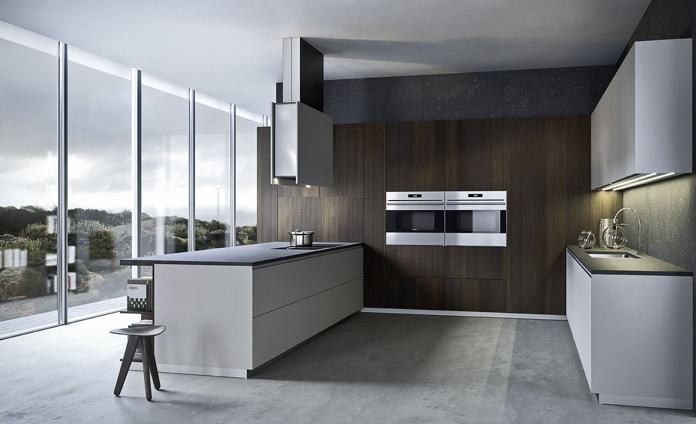 30 degree Cut along the entire topside for the ease of opening of the doors. Of the upper drawers and the side of the tall units for a comfortable and ergonomic grip. Available in a multitude of finishes, lacquers, wood veneer, Fenix laminate. This handle-less model is a definition of a contemporary kitchen design.